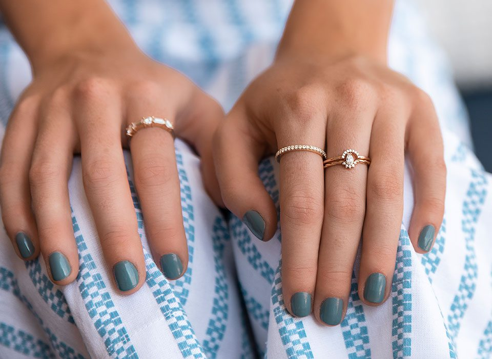 Close up of hands modeling moissanite rings