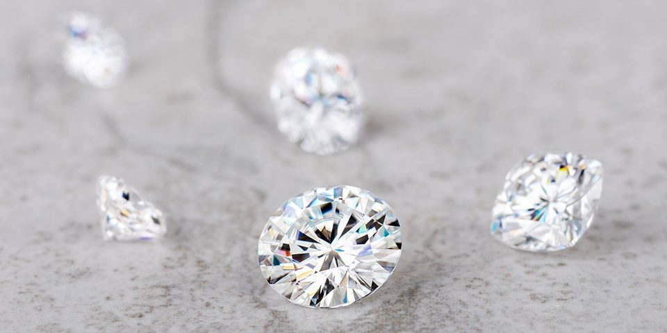 Diamonds and moissanite placed near each other for comparison