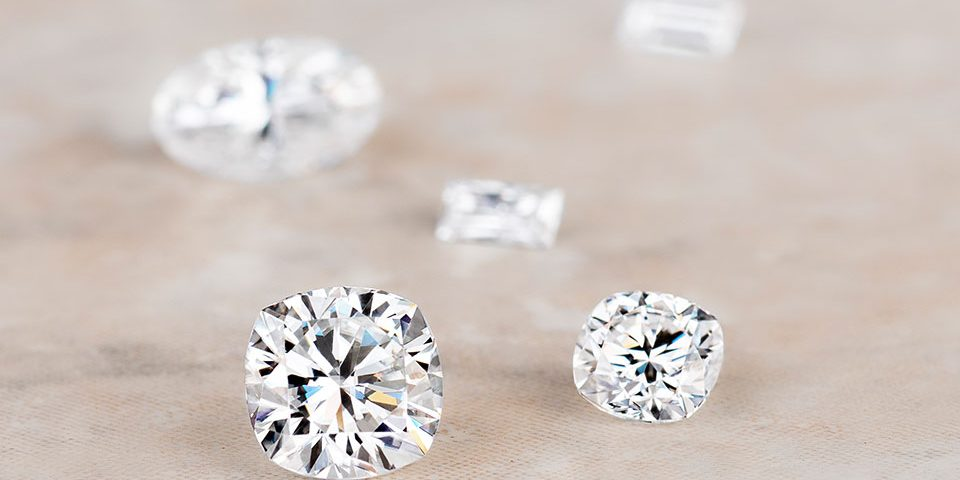 Diamonds and moissanite side by side