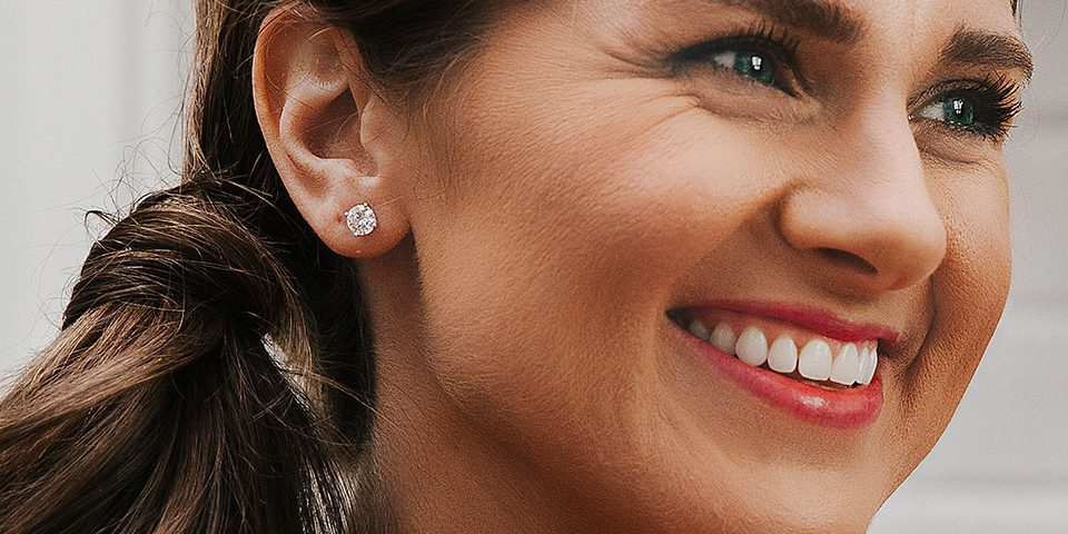 Woman modeling a moissanite stud earring