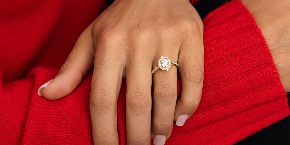 Hand modeling a moissanite engagement ring with a gold band